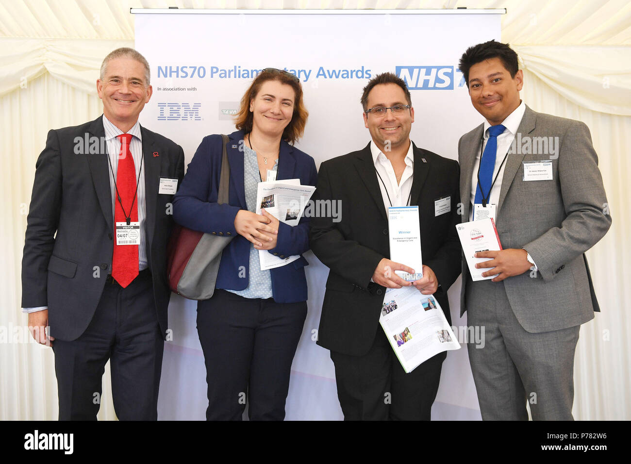 Dr David Raven (second right) receives his Excellence in Urgent and Emergency Care Award from Simon Gillespie (first left) and Drv Jeeves Wijesuriya (first right) during the NHS70 parliamentary awards for the 70th anniversary of the NHS at the House of Commons in Westminster, London. - Stock Image