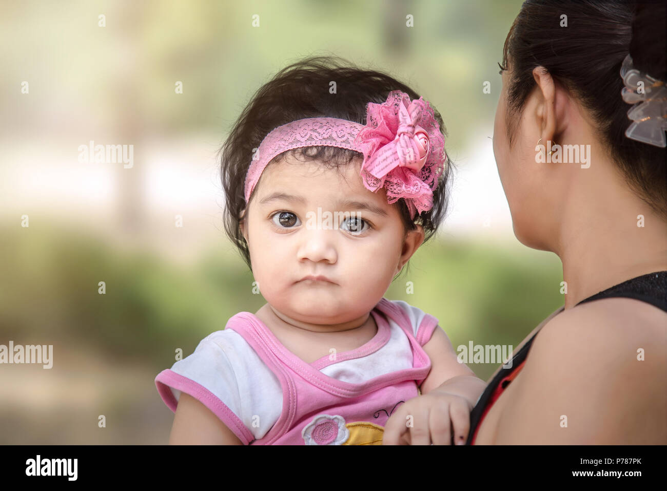 Sad Indianasian Baby Girl In Mother Arm Stock Photo 211008747 Alamy