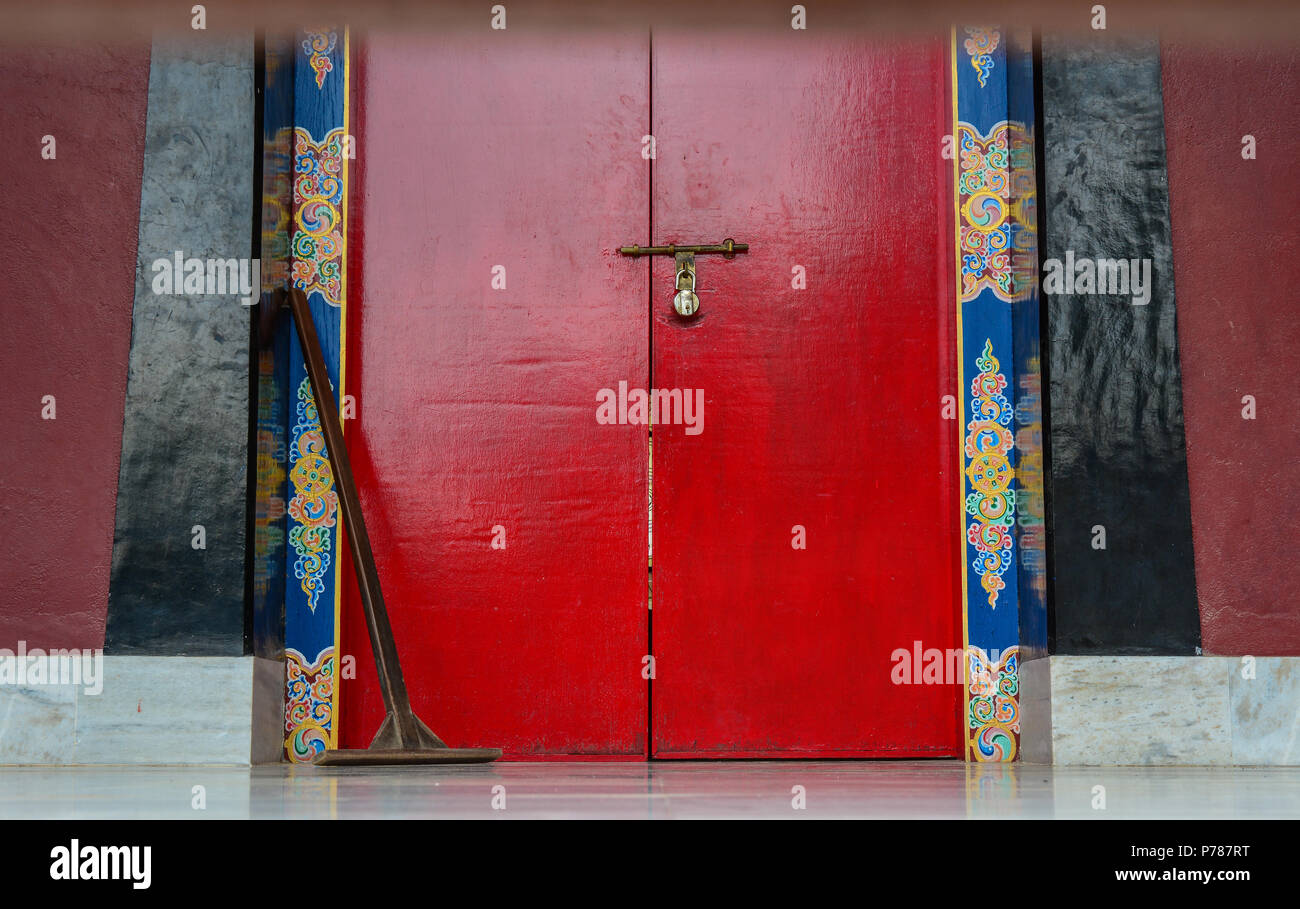 Wooden door of ancient Bhutanese Buddhist temple in Bodhgaya, India. Bodh Gaya is the most revered of all Buddhist sacred sites. - Stock Image