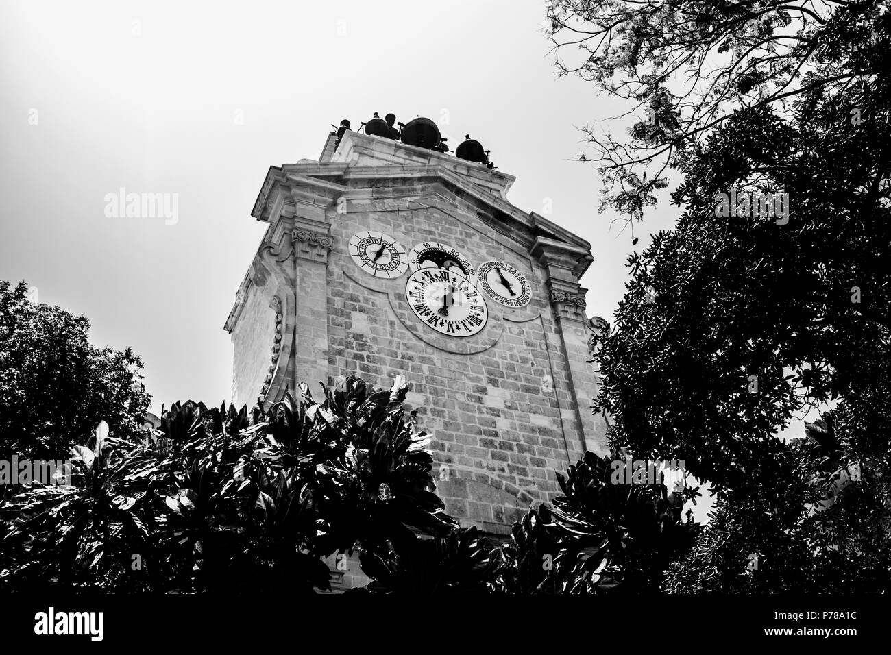 An old clock tower in black and white located in Valletta, Malta. - Stock Image