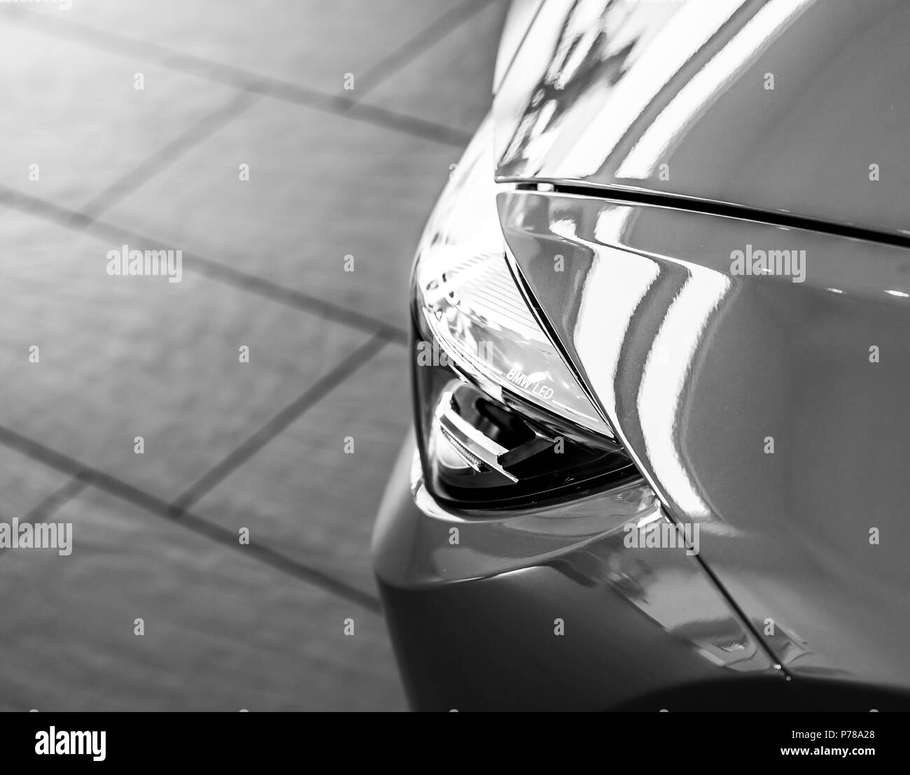 The headlight of a modern BMW sports car - Stock Image