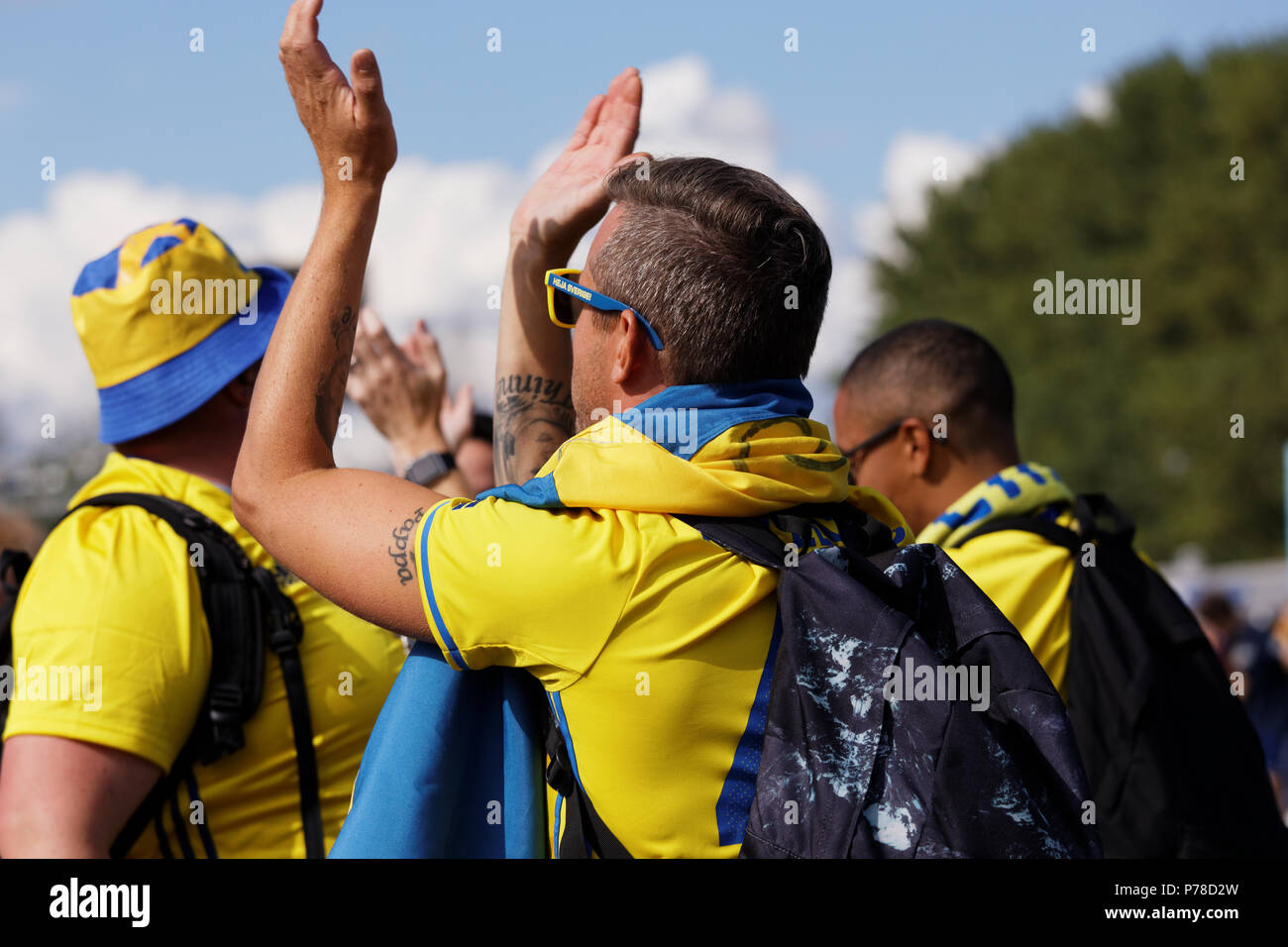 St. Petersburg, Russia - July 3, 2018: Swedish football fans singing at Saint Petersburg stadium before the match of FIFA World Cup 2018 Sweden vs Swi - Stock Image