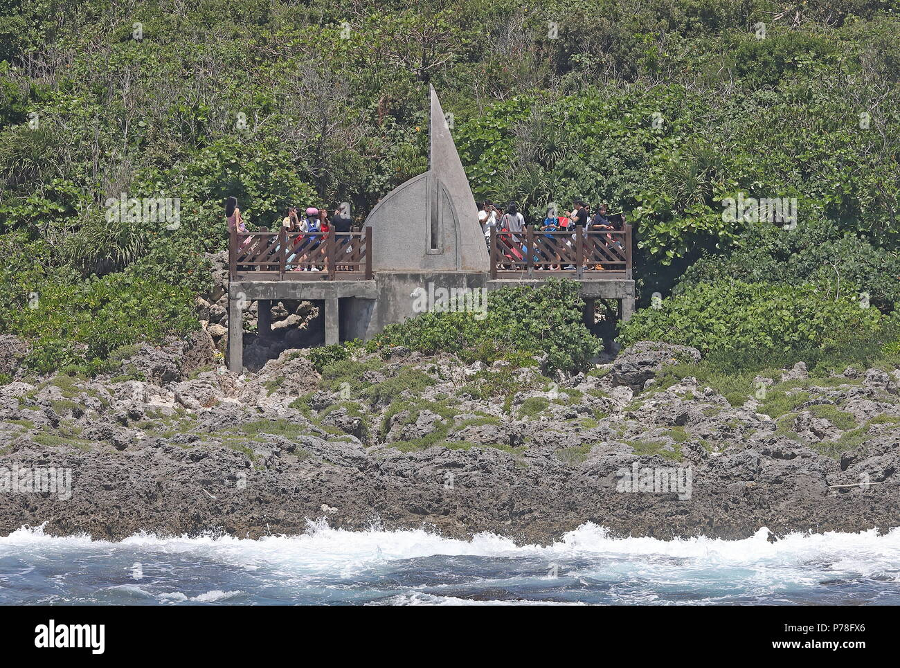 Tourists on watchpoint at most southerly end of the island  Taiwan                 April - Stock Image