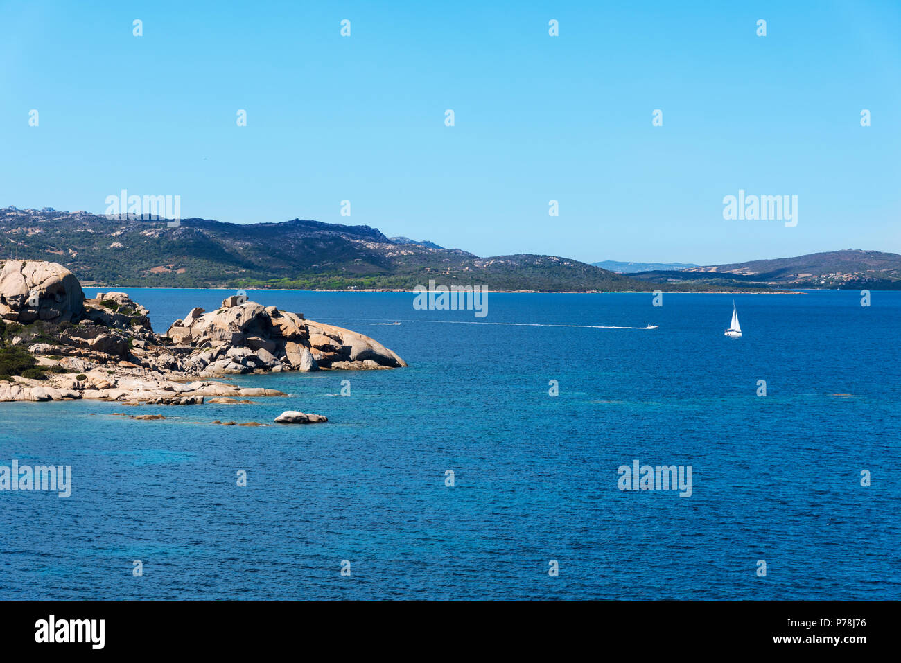a view of the Mediterranean sea and a group of rock formations in a quiet beach in the coast of Baja Sardinia, in the famous Costa Smeralda, Sardinia, - Stock Image