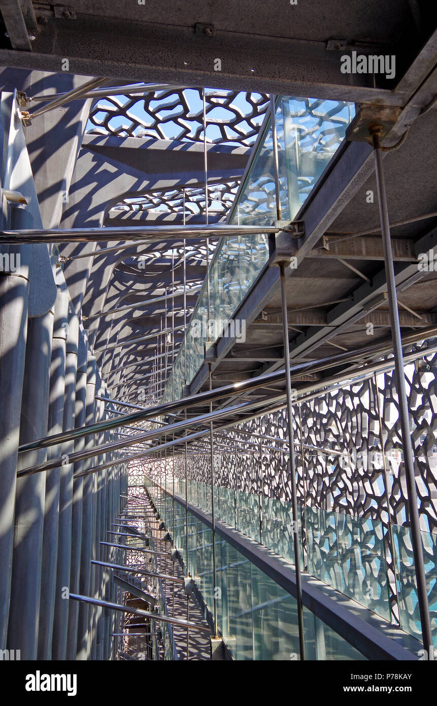 Marseille, MuCEM, View of the public pedestrian ramp between the outer latticework shell & the building itself, linking all floors Stock Photo