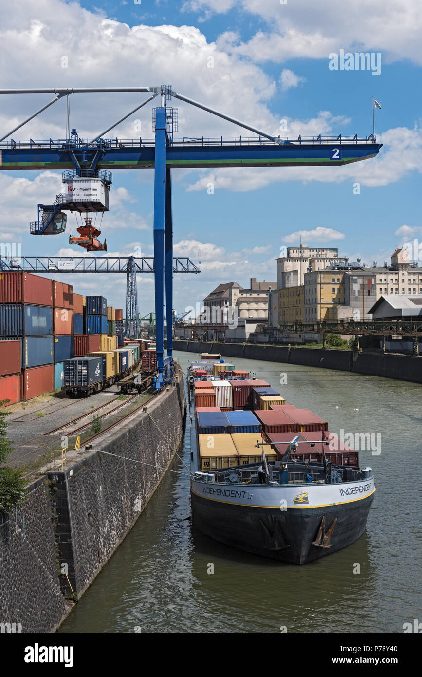 Container loading in a container handling crane in the east harbor, Frankfurt, Germany - Stock Image