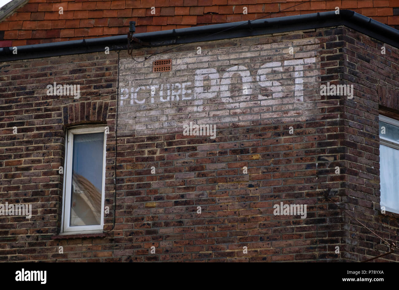 Picture Post advert on the side of a house in Bexhill on Sea - Stock Image