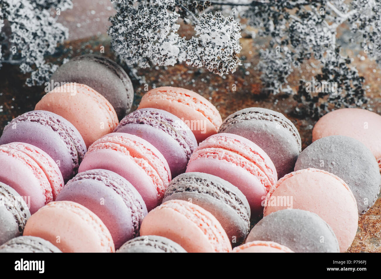 Freshly baked multi-colored macaroons close-up, selective focus. - Stock Image