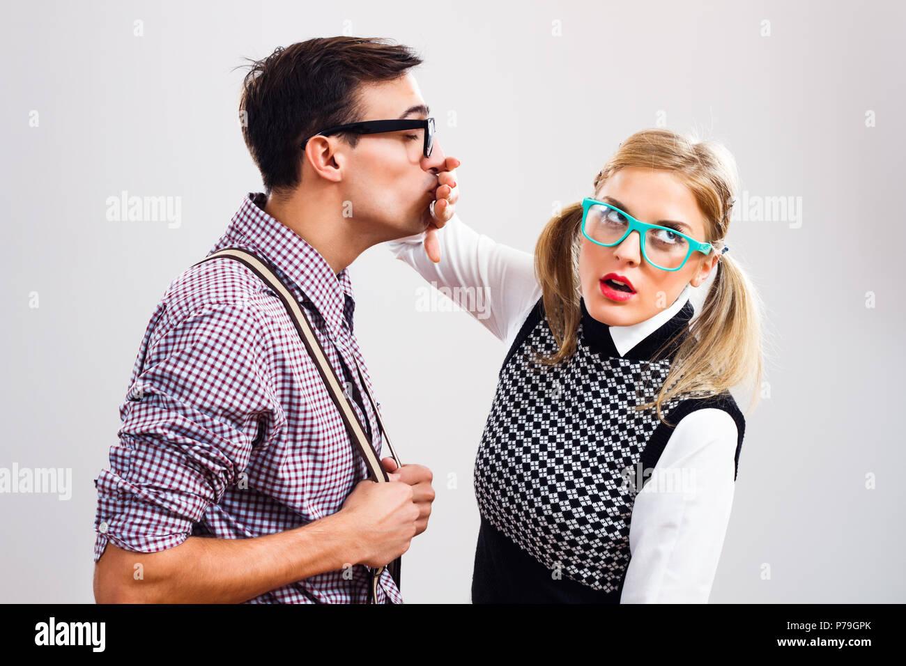 Nerdy woman doesn't like this nerdy man. - Stock Image