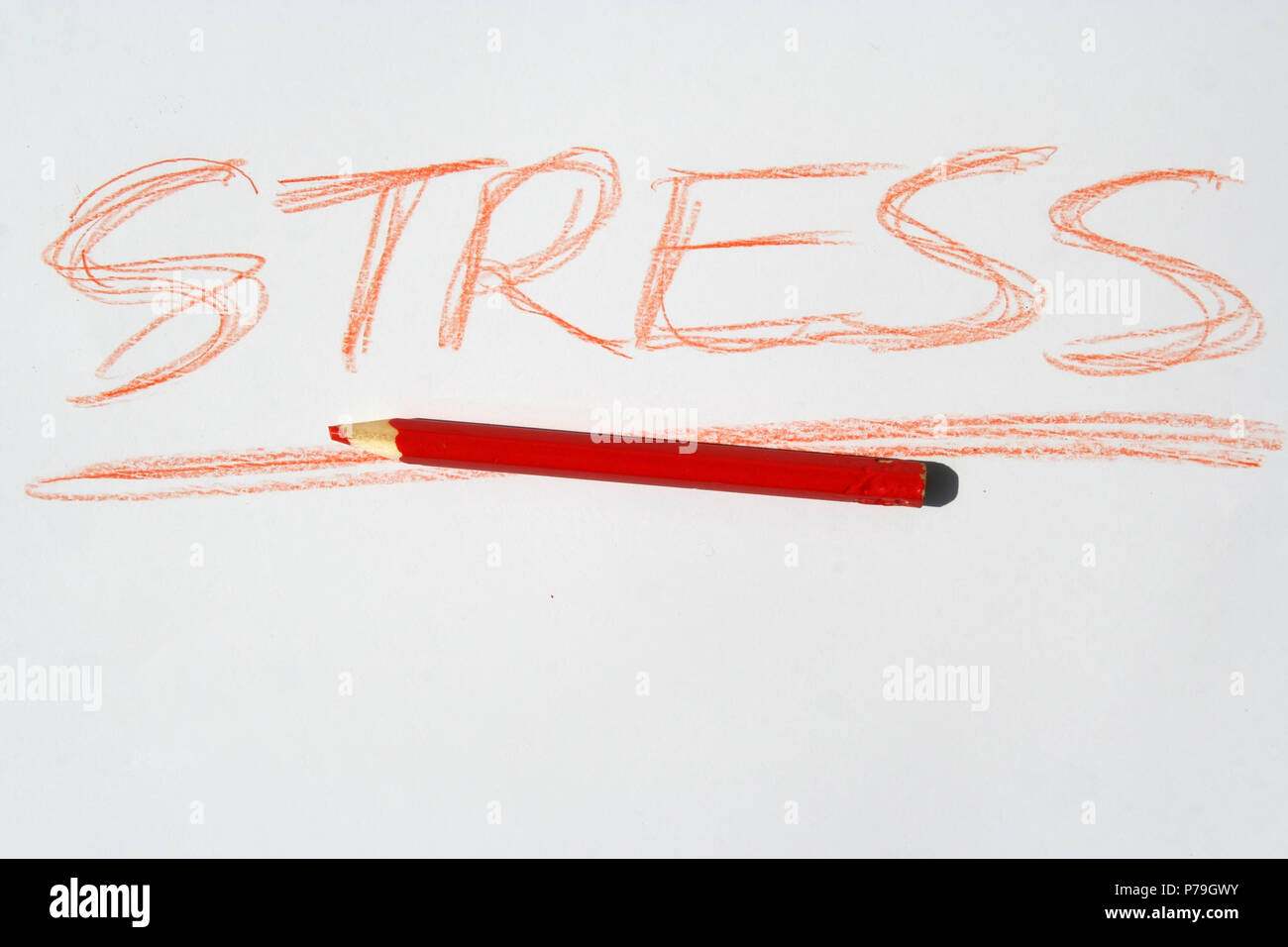 Stress note written with red crayon. Stock Photo