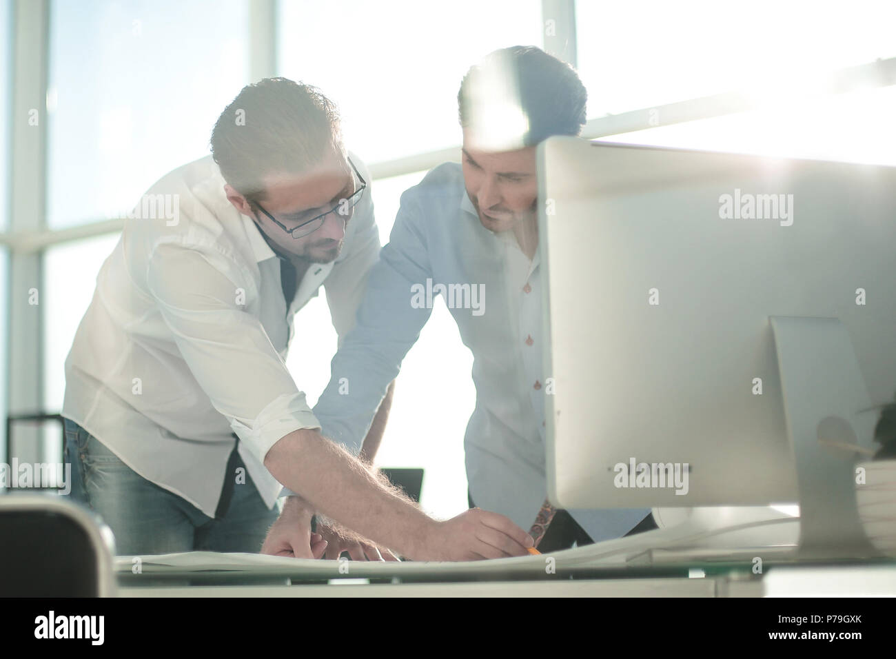 engineer and architect look at the sketches of the project - Stock Image