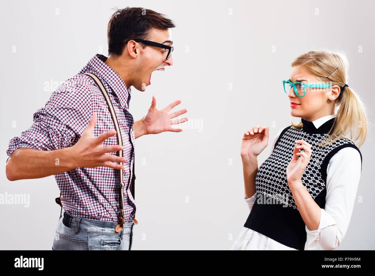 Nerdy couple having conflict. - Stock Image