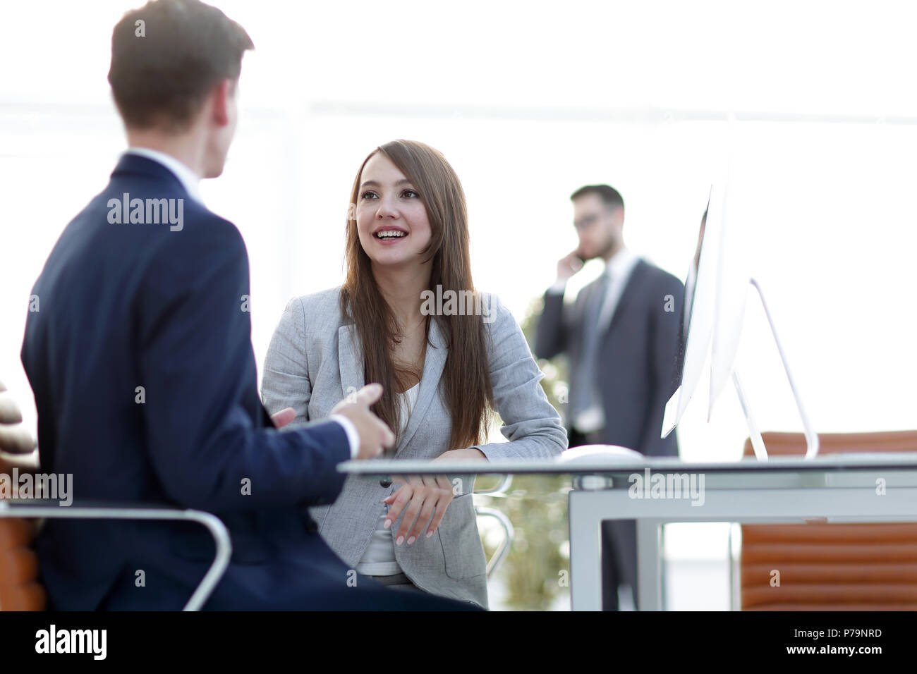 business woman shaking hands with a business partner. - Stock Image
