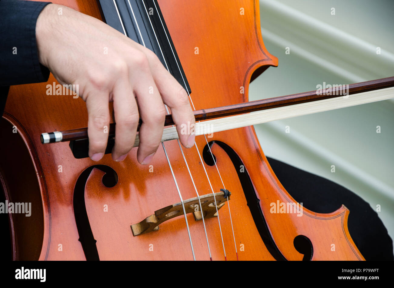 Art and artist. Young elegant man violinist playing violin on black. Classical music. little boy musical instrument. - Stock Image