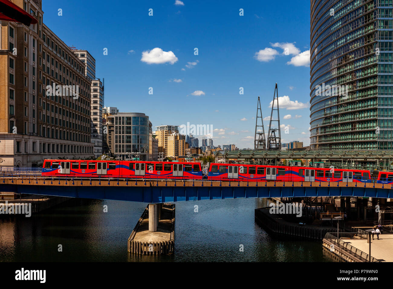 A Docklands Light Railway Train Crossing The River At Canary Wharf, London, United Kingdom - Stock Image