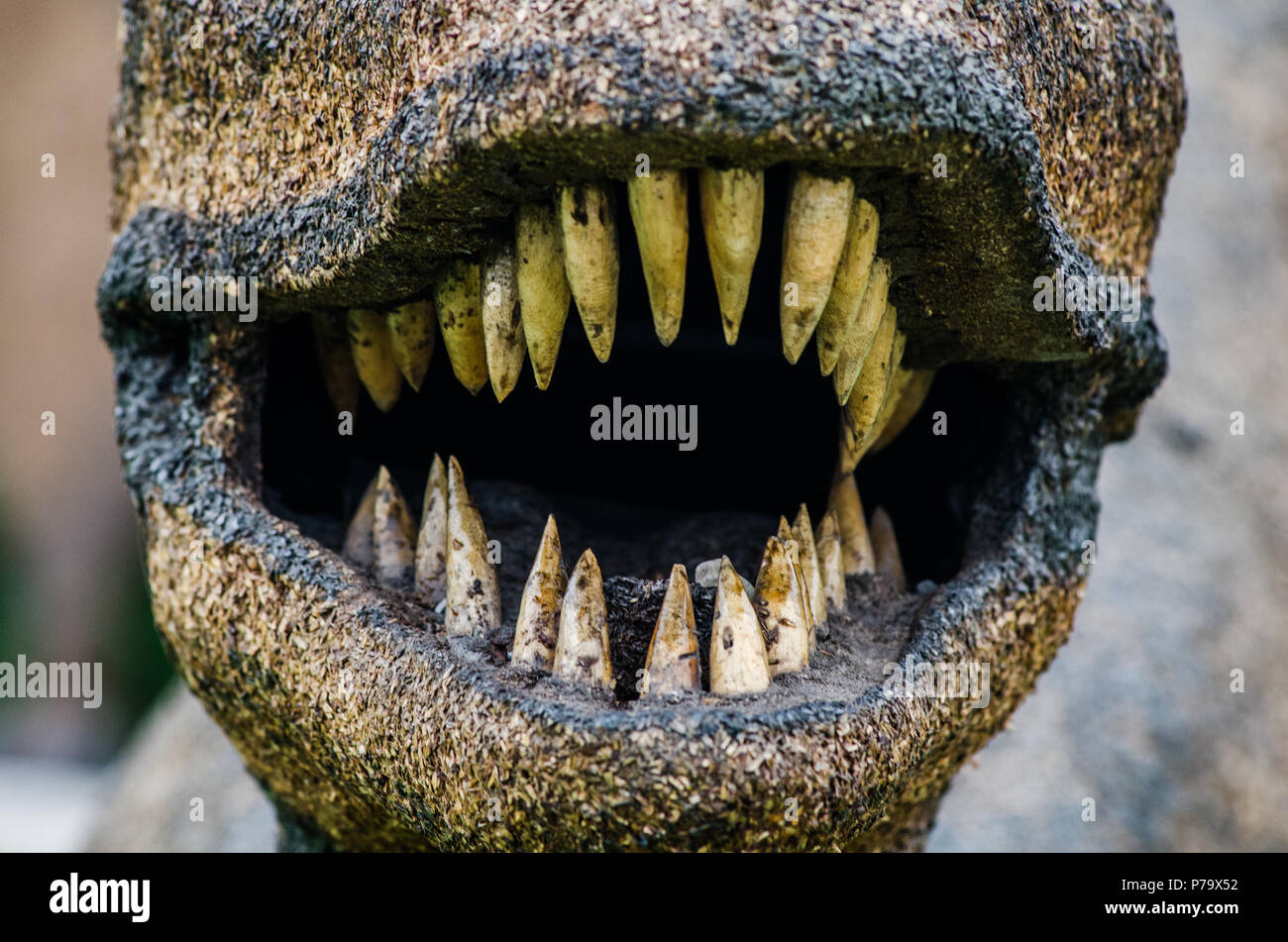 Dinosaur mouth with sharp teeth, terrifying photograph - Stock Image