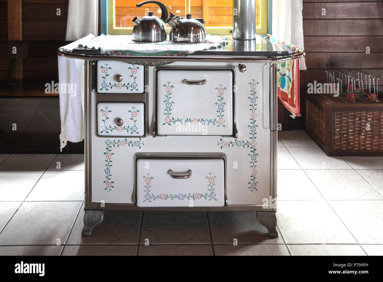 Santa Catarina, Brazil. Old fashioned stove with kettles in a rustic kitchen chalet. - Stock Image