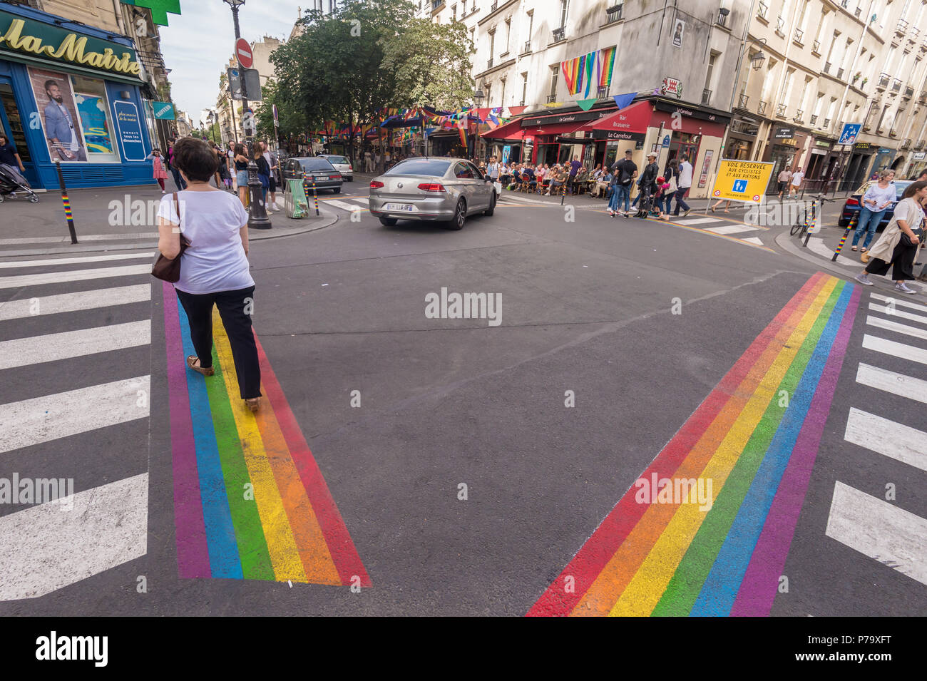 Paris, France - 24 June 2018: Gay pride flag crosswalks in Paris gay village (Le Marais) - Stock Image