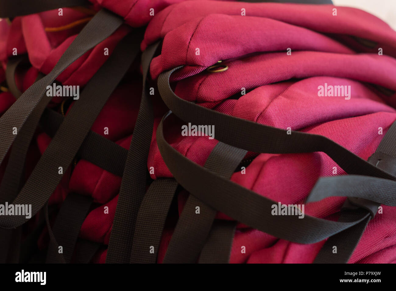 Pile of hand crafted red waist bags. - Stock Image
