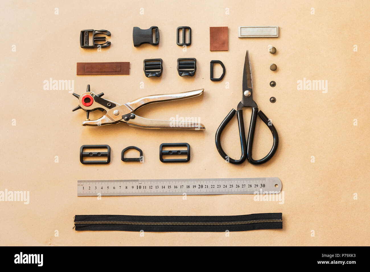 Flat lay of tools and accessories for bags of clothes making. - Stock Image