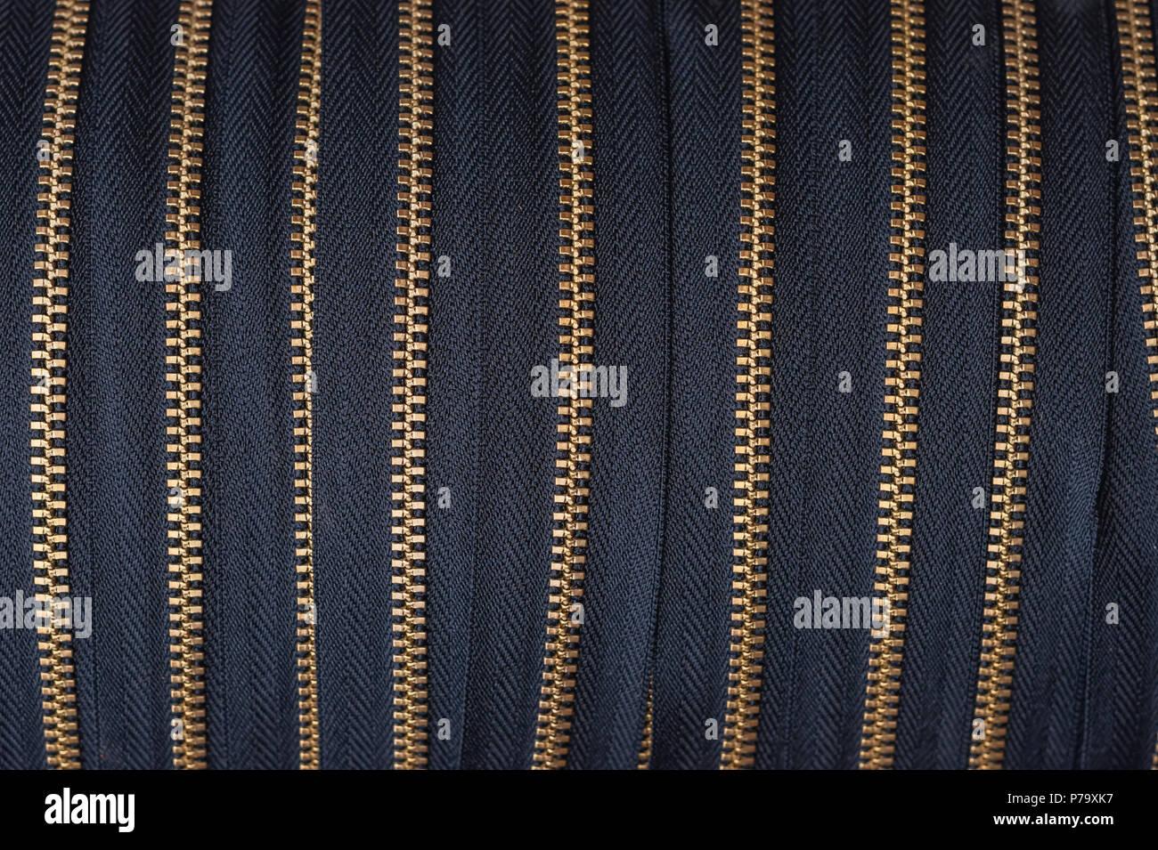 Huge rolls of zippers. - Stock Image