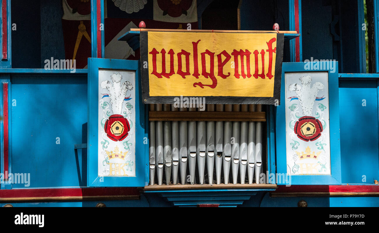 Banner for the Medieval Band Wolgemut over organ pipes. Maryland RenFest stage backdrop for live performances of this international minstrel troupe. - Stock Image