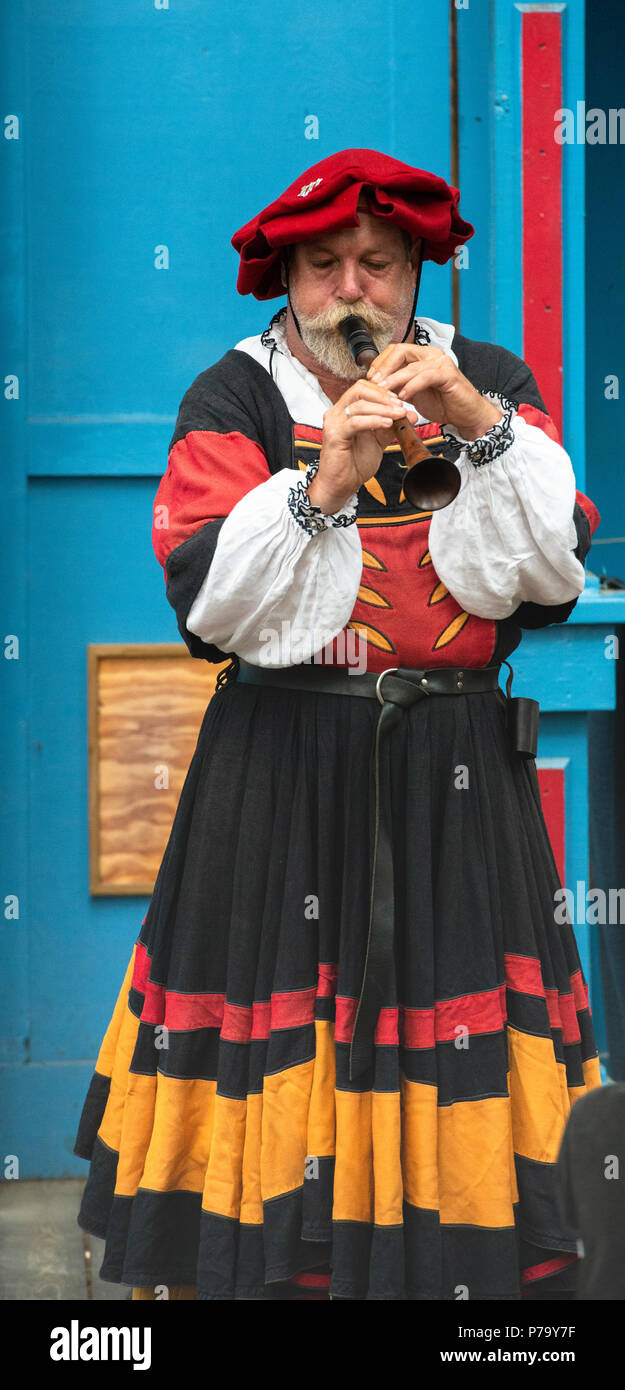 International Minstrel Troupe wind instrument performer from the group Wolgemut. Playing the Schreiepfeife in Tudor period costume at the MD RenFest. - Stock Image