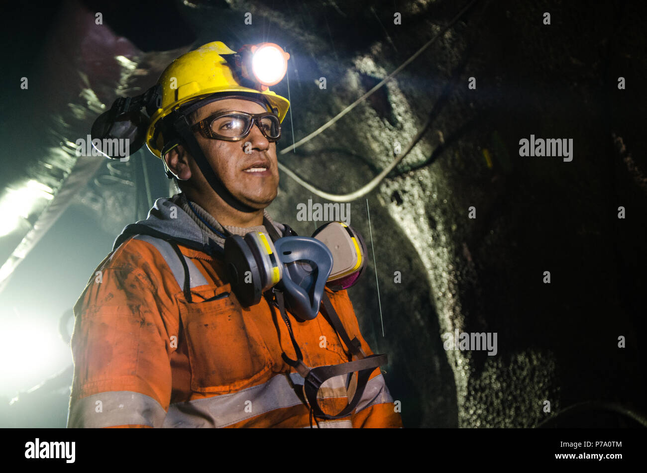Cerro de Pasco, Peru - July 14th 2017: Miner in the mine. Miner inside the mine well uniformed with a look of confidence. - Stock Image