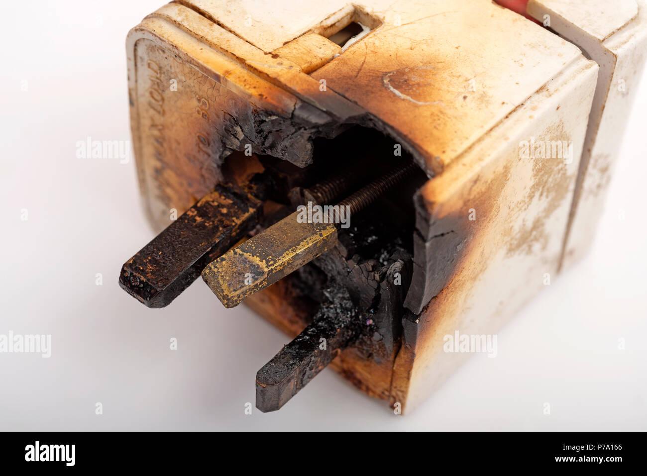 Fired damaged 3-pin electrical plug - Stock Image
