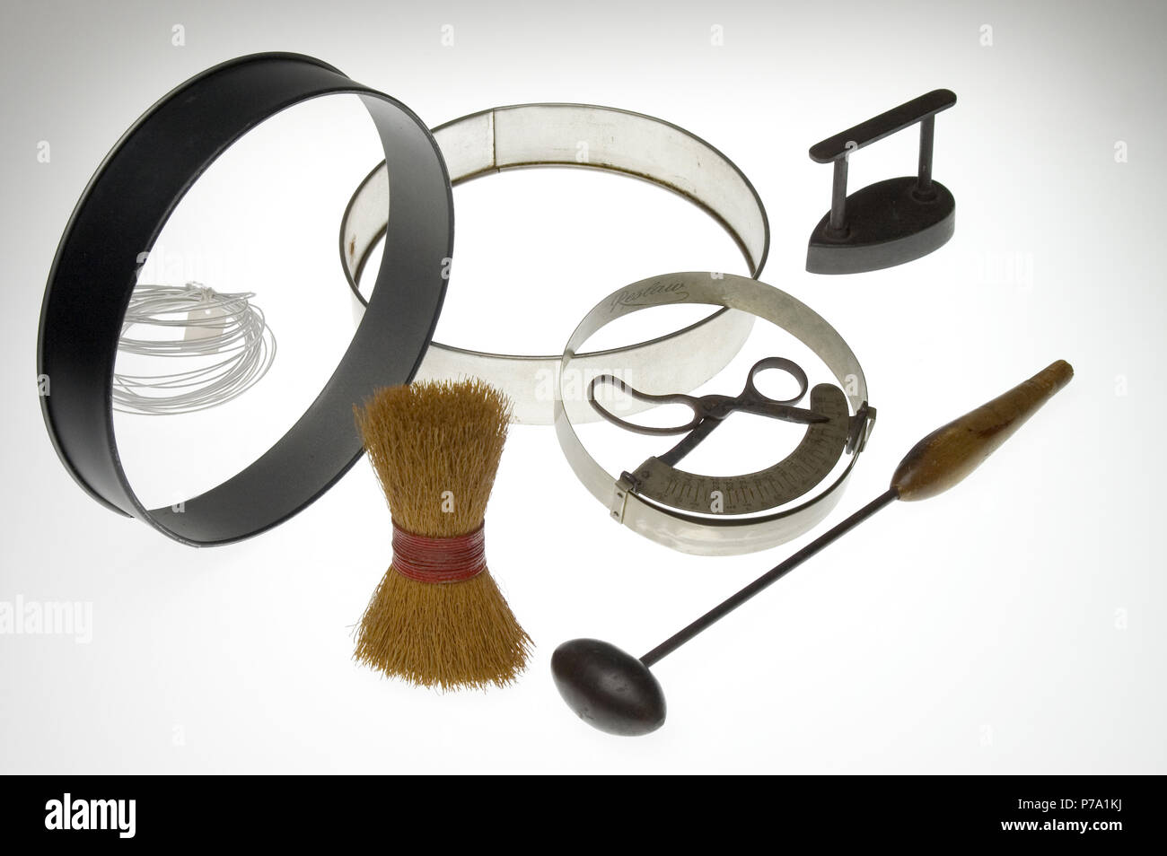 millinery hat making tools shot on a white light box - Stock Image