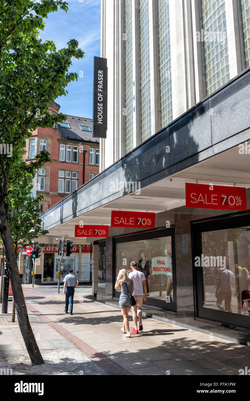 People walking past a House of Fraser Department Stored adorned with Sale signs - Stock Image