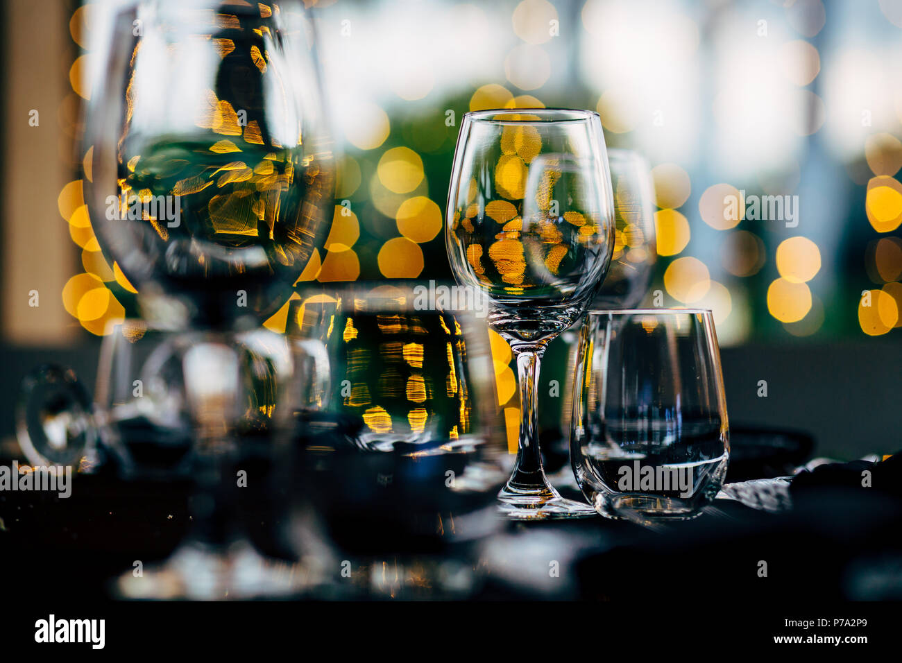 Luxury table settings for fine dining with and glassware, beautiful blurred  background. For events, weddings. WEDDINGS, Wedding detals and planing. - Stock Image