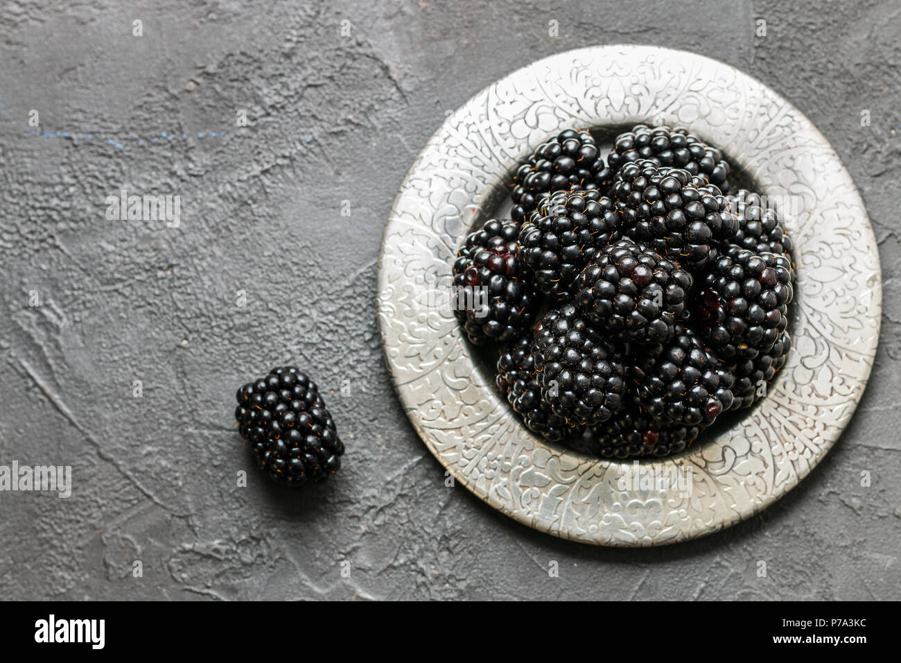Ripe berries. Fresh juicy organic BlackBerry. Selective focus, top view, and copy space - Stock Image