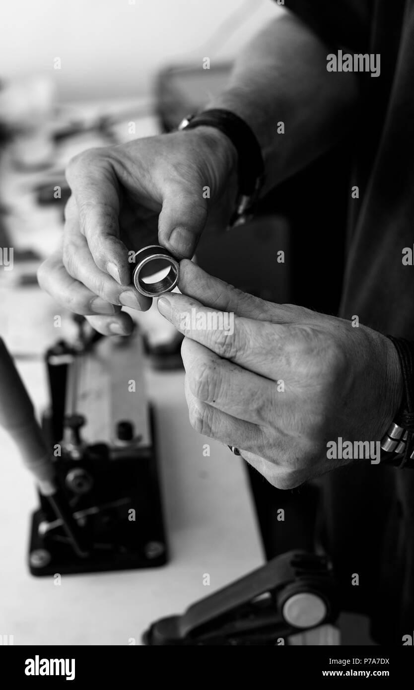 Mi amigo Javier, trabajando en su taller de forma totalmente artesanal.  My friend Javier, working in his workshop in a totally handmade way. - Stock Image