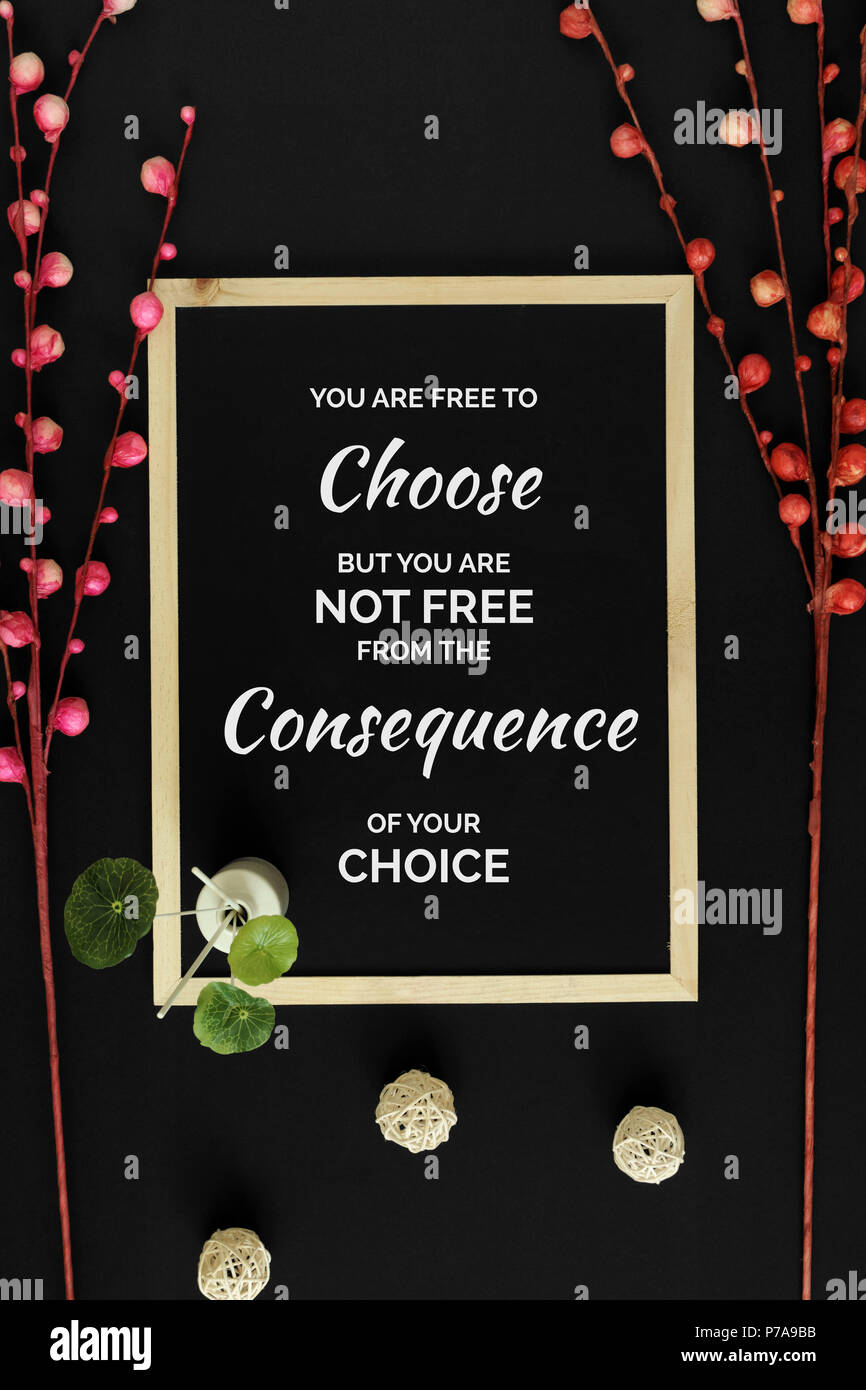 Motivational and inspirational quote. Wisdom quote. Wood frame with flowers on black background with quote. Oriental minimal flat lay. - Stock Image