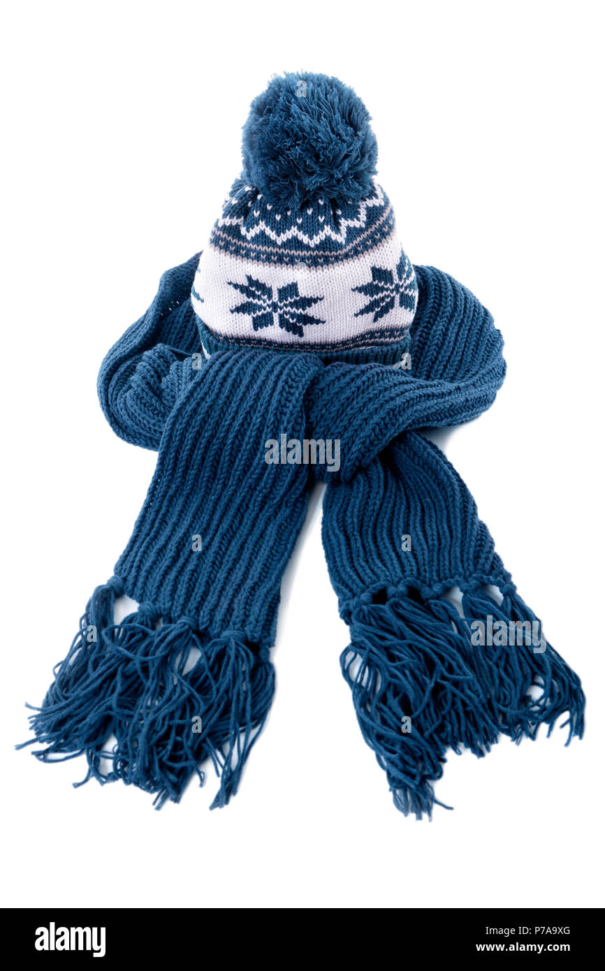 bf0b2d7c0e2 Blue knitted winter bobble hat and scarf isolated on a white background.