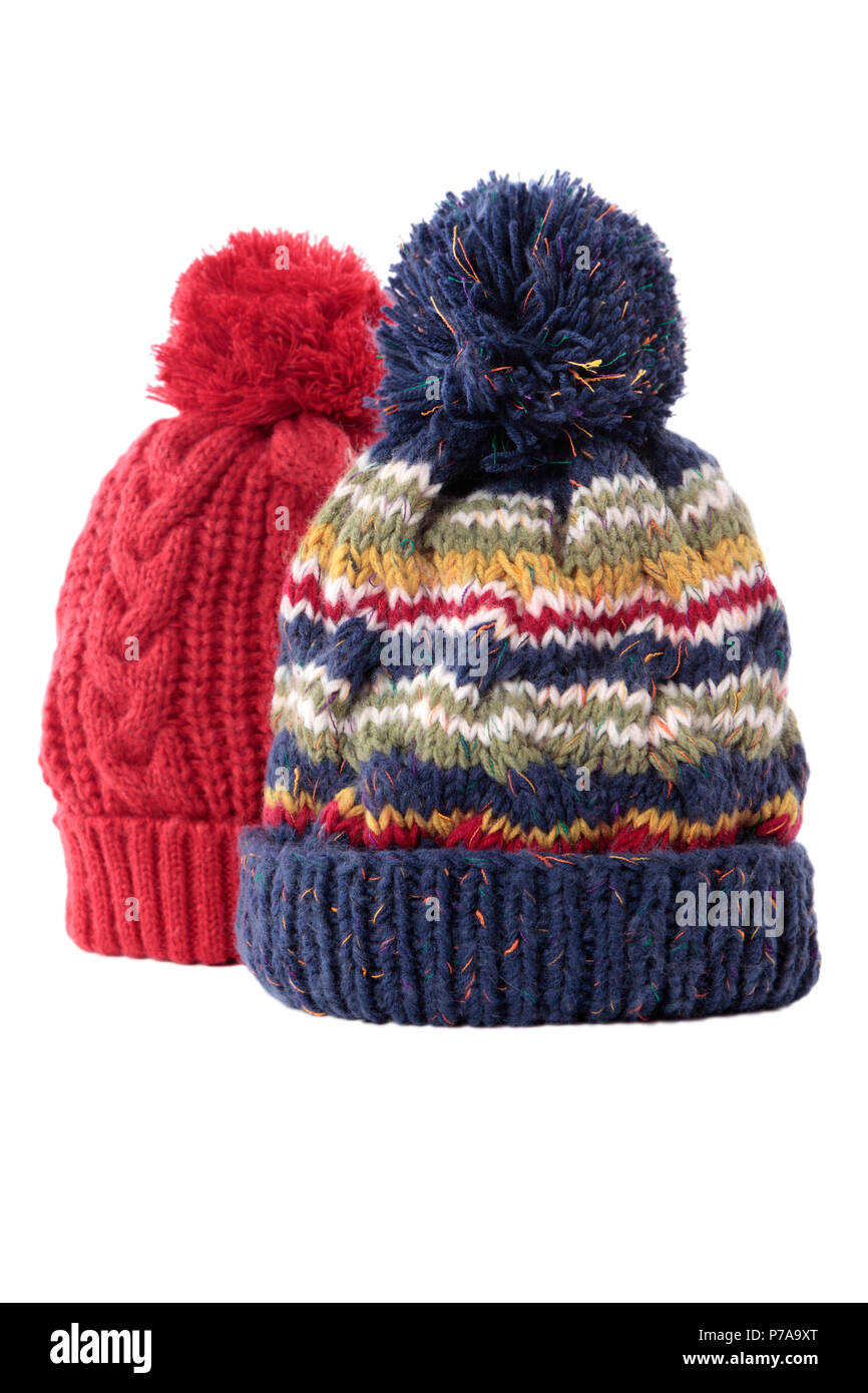 Two chunky knit bobble hats or knit hats isolated on a white background. - Stock Image