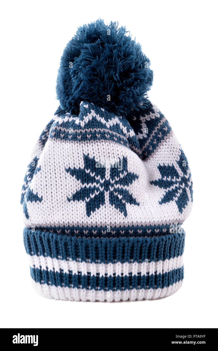 4c5d8940a31 Blue knitted bobble hat or ski hat with snowflake pattern isolated on a white  background.
