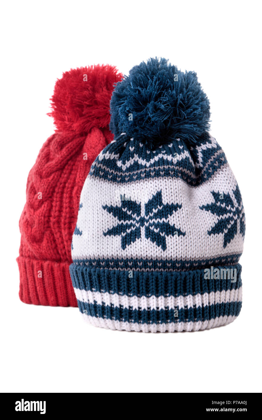 1d49fa00d94 Two knitted bobble hats or ski hats isolated on a white background ...