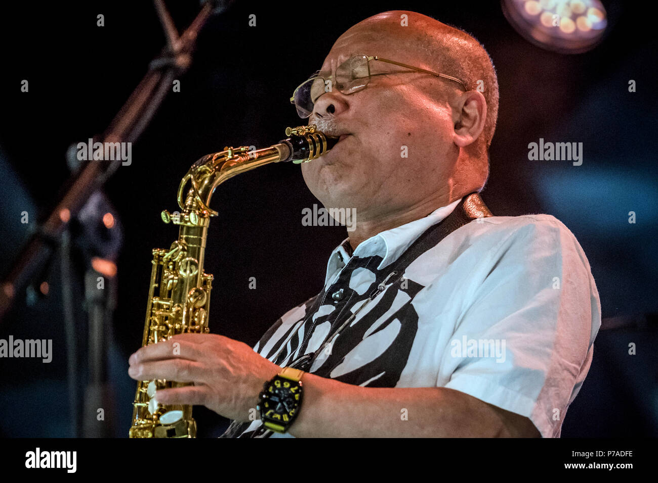 Roskilde, Denmark. 4th July, 2018. The international jazz band Paal Nilssen-Love's Japan Free Jazz and Noise performs a live concert during the Danish music festival Roskilde Festival 2018. Here Japanese saxophonist Akira Sakata is seen live on stage. (Photo credit: Gonzales Photo - Kim M. Leland). Credit: Gonzales Photo/Alamy Live News - Stock Image
