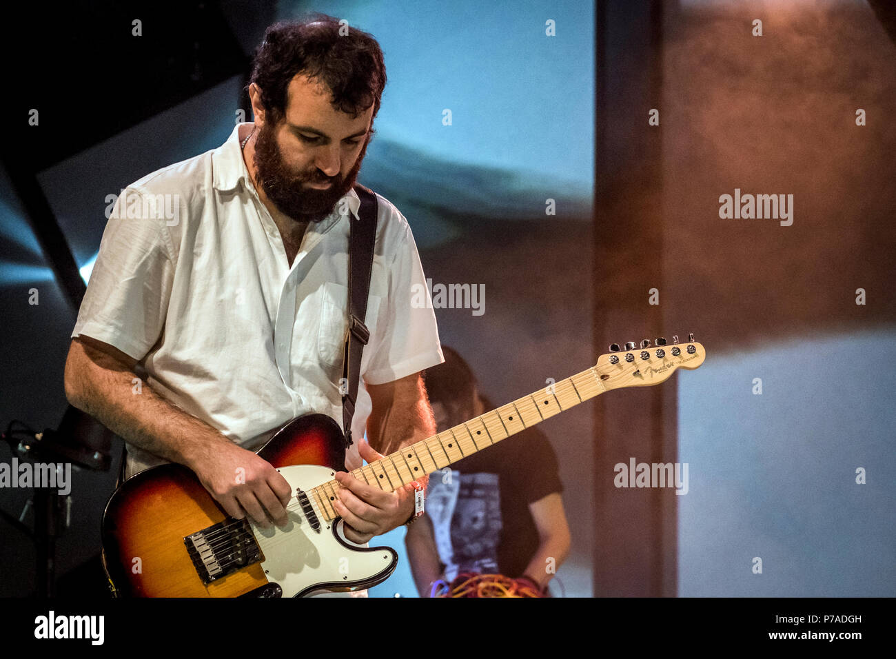Roskilde, Denmark. 4th July, 2018. The international jazz band Paal Nilssen-Love's Japan Free Jazz and Noise performs a live concert during the Danish music festival Roskilde Festival 2018. Here Brazilian guitarist Kiko Dinucci is seen live on stage. (Photo credit: Gonzales Photo - Kim M. Leland). Credit: Gonzales Photo/Alamy Live News - Stock Image