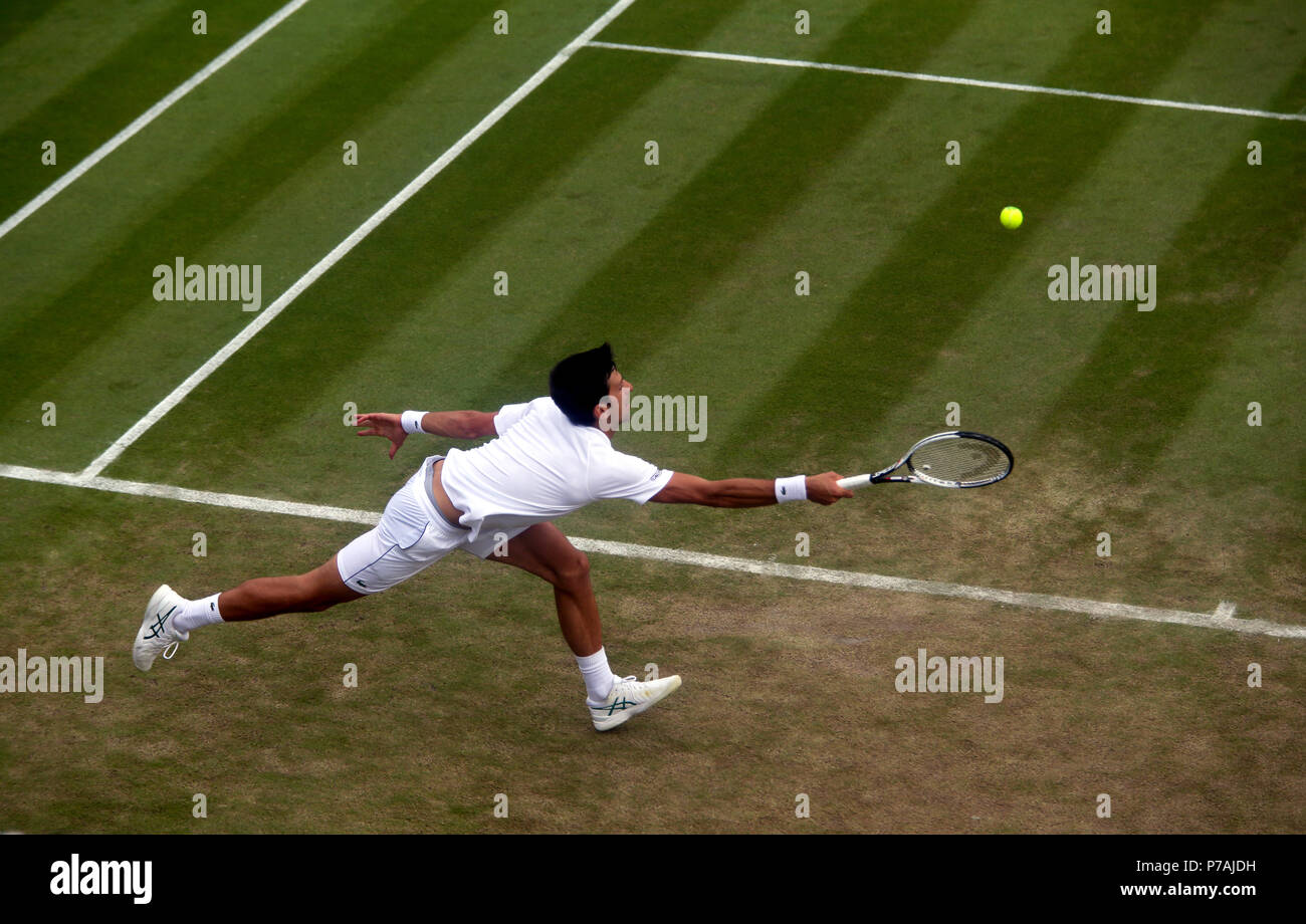 London, England - July 5, 2018.  Wimbledon Tennis:  Novak Djokovic of Serbia reaches for a forehand during his second round victory over Horacio Zeballos of Argentina today at Wimbledon Credit: Adam Stoltman/Alamy Live News - Stock Image
