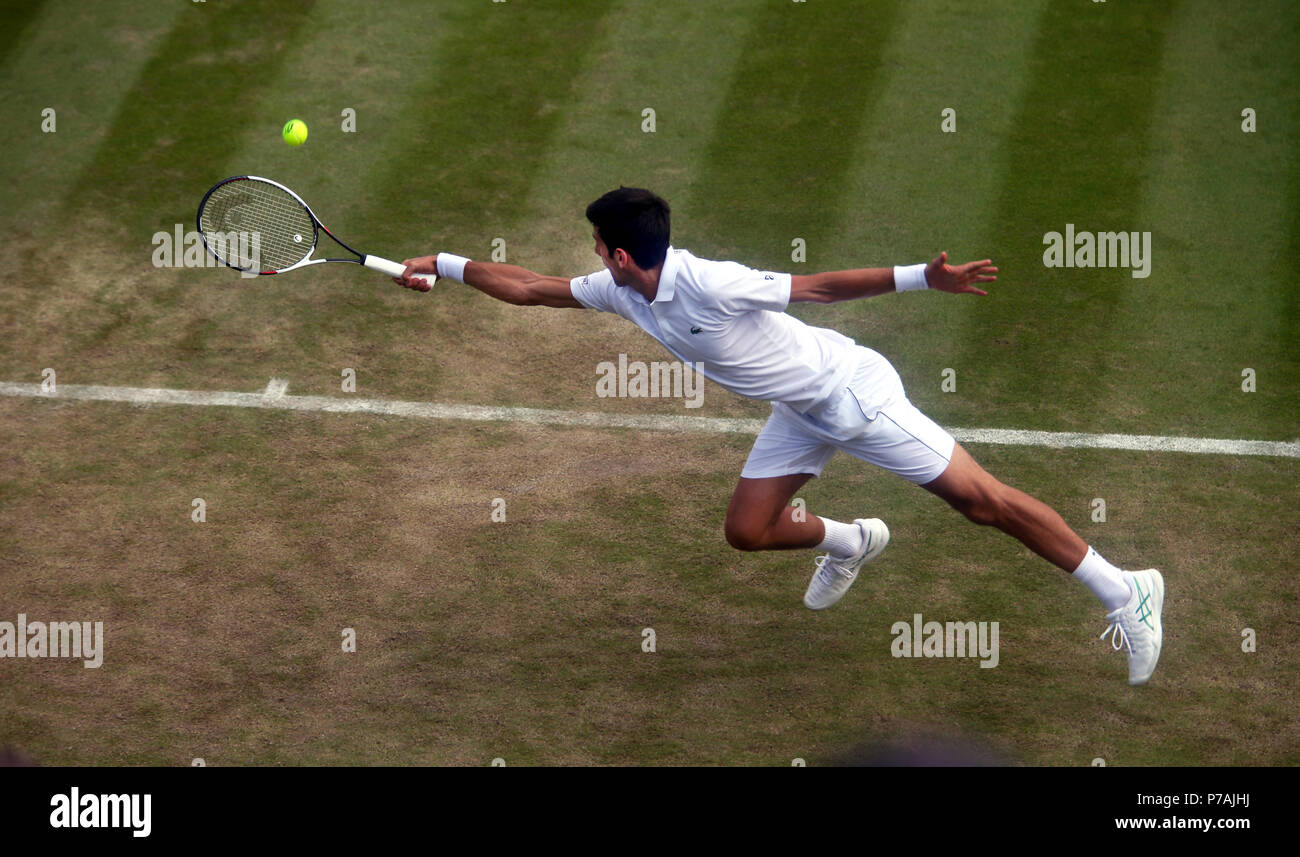 London, England - July 5, 2018.  Wimbledon Tennis:  Novak Djokovic of Serbia lunges for a backhand during his second round victory over Horacio Zeballos of Argentina today at Wimbledon Credit: Adam Stoltman/Alamy Live News - Stock Image