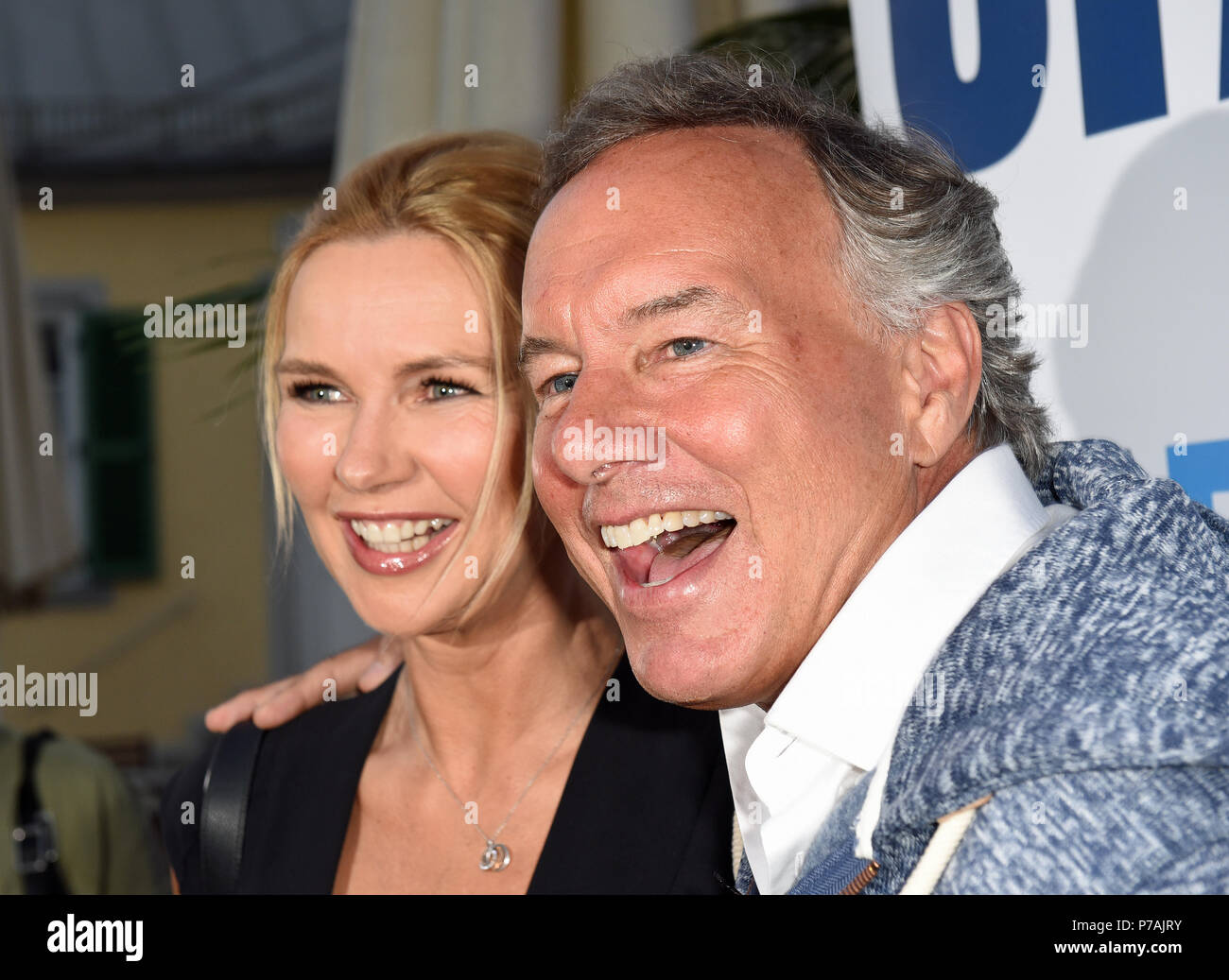 Munich, Germany. 02nd July, 2018. Actress Veronica Ferrs and Nico Hofmann, CEO of UFA, smiling at the reception on the occasion of Filmfest Munich at Cafe Reitschule. Credit: Ursula Düren/dpa/Alamy Live News - Stock Image