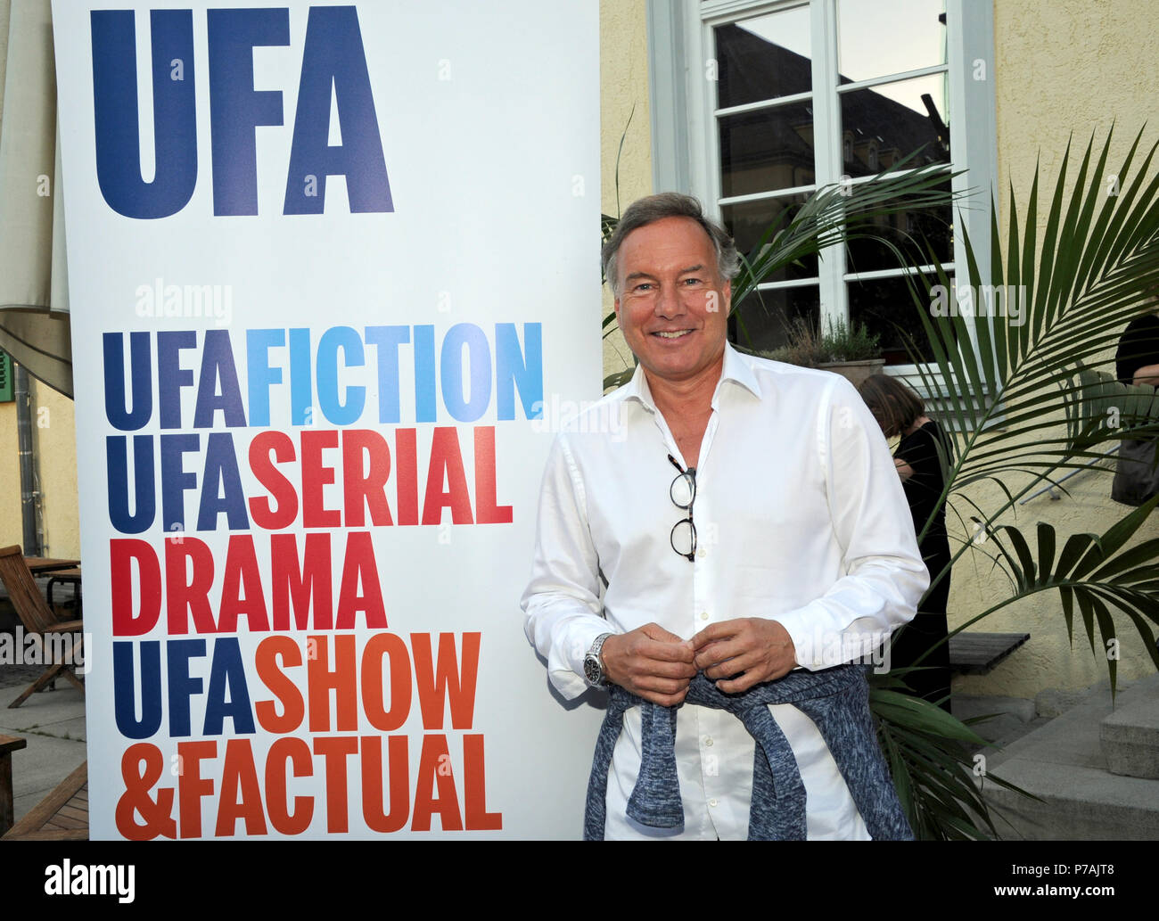 Munich, Germany. 02nd July, 2018. Nico Hofmann, CEO of UFA, smiles at the reception on the occasion of Filmfest Munich at Cafe Reitschule. Credit: Ursula Düren/dpa/Alamy Live News - Stock Image