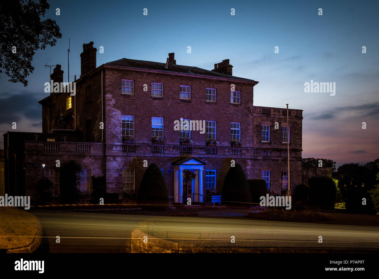 Knaresborough House, Knaresborough, North Yorkshire, UK - 5 July 2018: Knaresborough House in Knaresborough, North Yorkshire, UK, lit up in blue to celebrate the 70th birthday of the NHS. Caught Light Photography/Alamy Live News - Stock Image