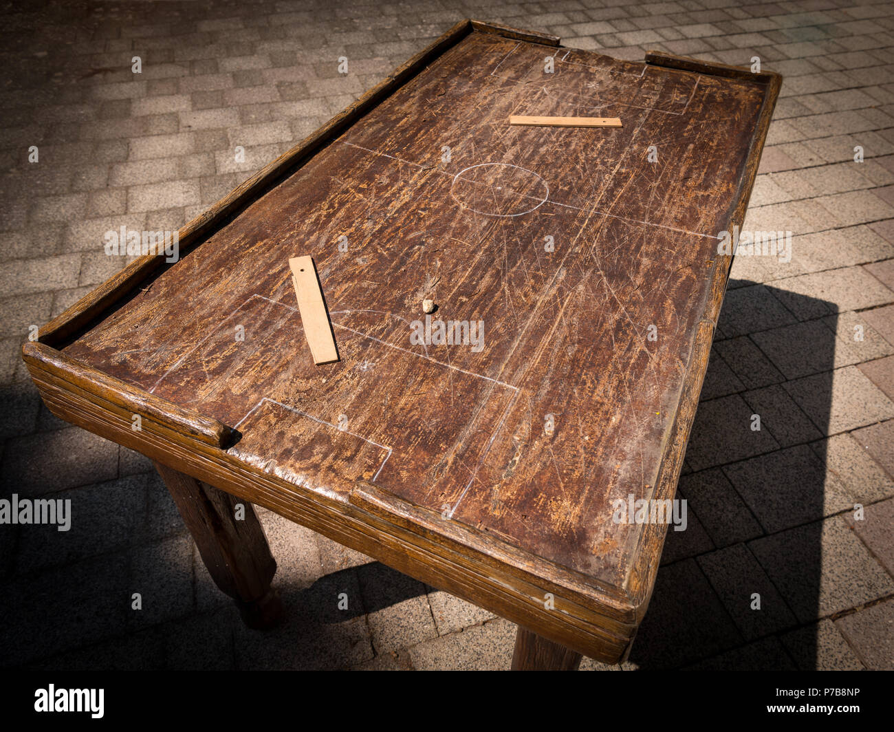 Old wooden table for playing table football, markings of matchfield and rulers - Stock Image