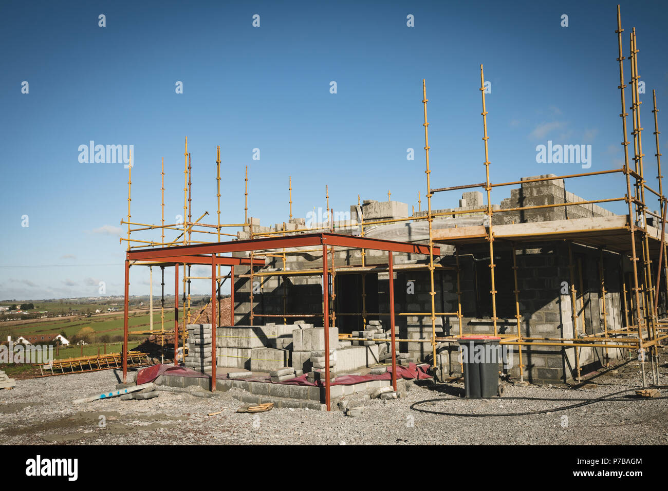 Scaffolding around the building at construction site - Stock Image