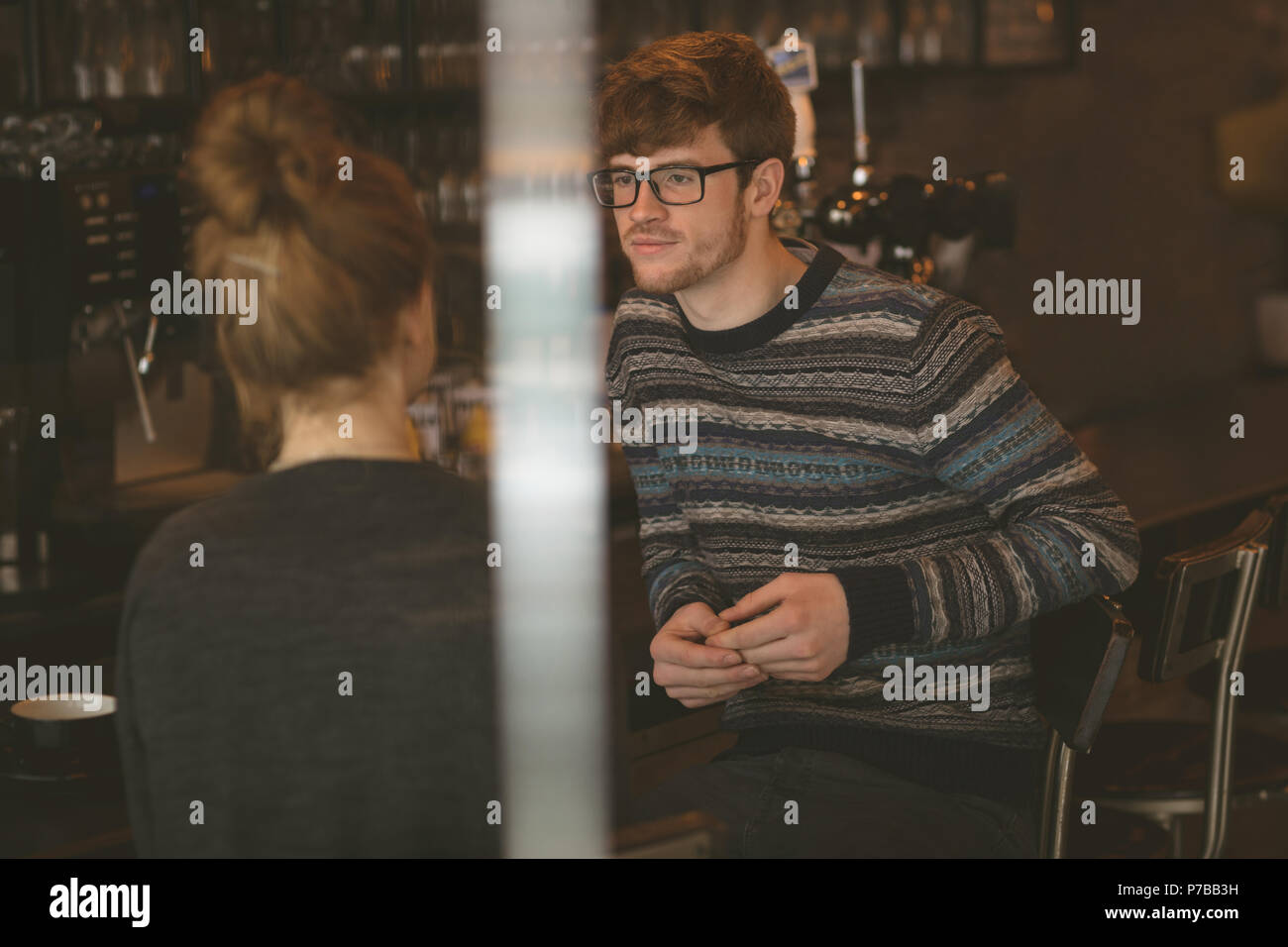 Couple talking to each other in the cafe - Stock Image