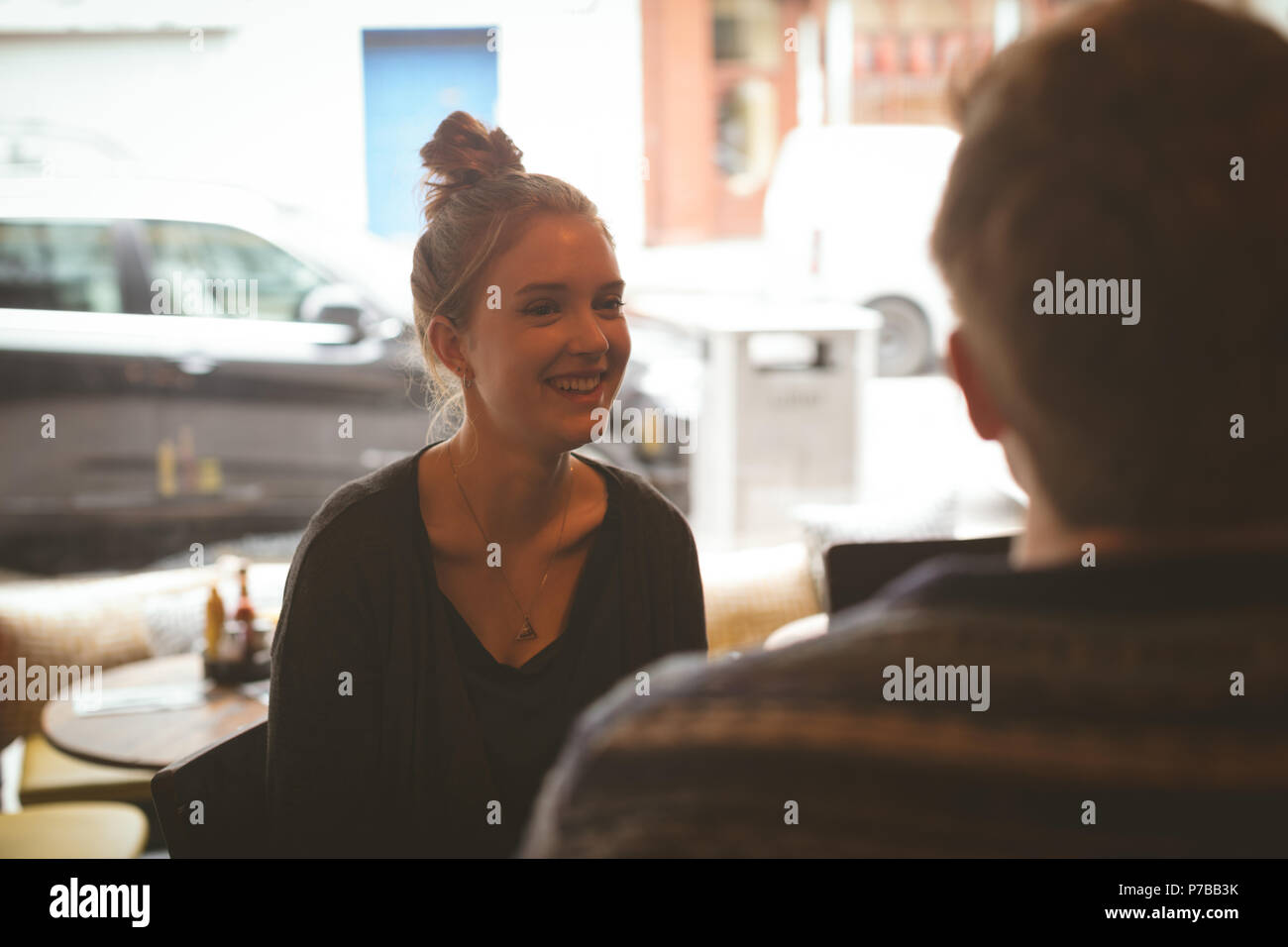 Woman talking to man in the cafe - Stock Image